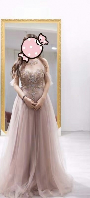 This dress is absolutely gorgeous. I'm impressed with the quality, the beading, the fabric..